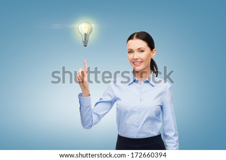 business, future technology and communication concept - businesswoman working with imaginary virtual screen