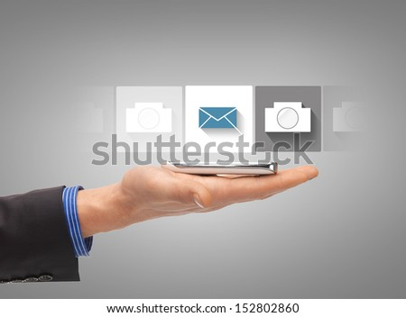 business, future technology and internet - hand with smartphone showing instant picture application - stock photo