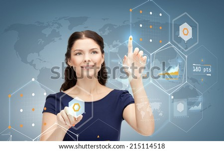 business, future, technology and people concept - smiling young businesswoman working with virtual screen - stock photo