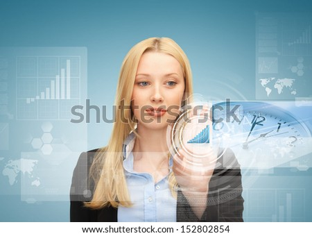 business, future technology and time management concept - businesswoman pointing at graph on virtual screen - stock photo