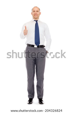 business, gesture and office concept - smiling businessman showing thumbs up standing full-length - stock photo
