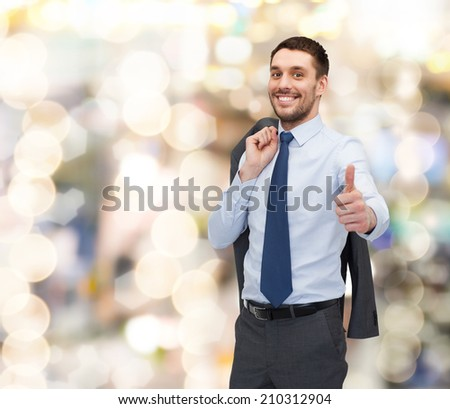 business, gesture and people concept - smiling young and handsome businessman showing thumbs up - stock photo
