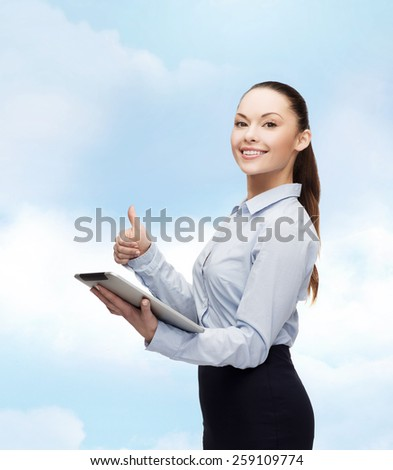 business, gesture, internet and technology concept - smiling woman looking at tablet pc computer showing thumbs up - stock photo