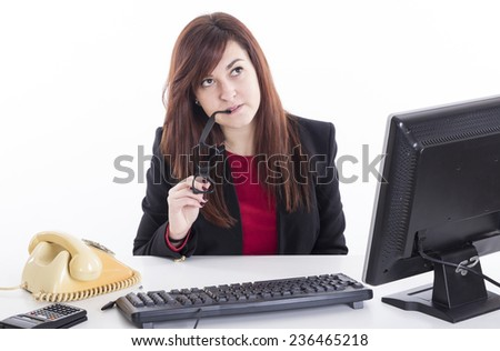 Business girl at office thinking about good job wearing black glasses - stock photo