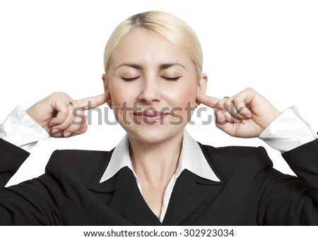 Business girl covered her ears with fingers - stock photo