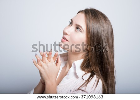 Business girl praying isolated on background
