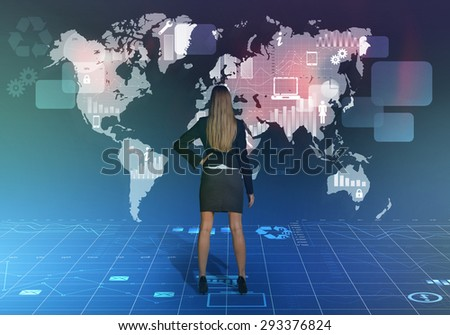 Business girl standing back and looking at the world map