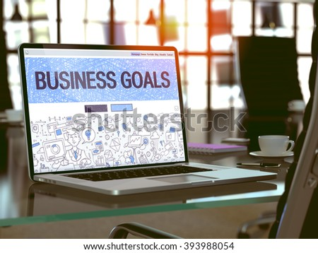 Business Goals - Closeup Landing Page in Doodle Design Style on Laptop Screen. On Background of Comfortable Working Place in Modern Office. Toned, Blurred Image. 3D Render. - stock photo
