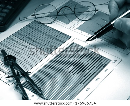Business graph analysis report monochrome in blue - stock photo