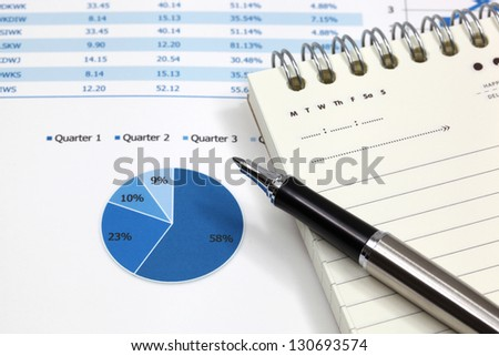 Business graph analysis report with pen - stock photo