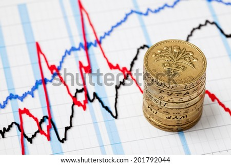 Business graph and money coins. - stock photo