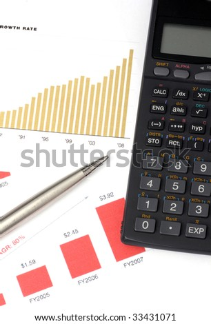 business graph, calculator and pen - stock photo