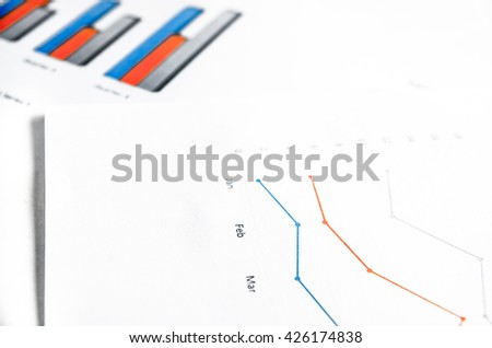 Business graph on white paper - stock photo