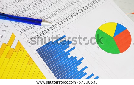 Business graphs and charts with a blue pen. - stock photo