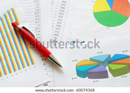 Business graphs and charts with a red pen - stock photo