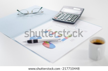 Business graphs with some accessories on a desk
