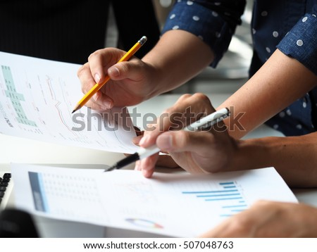 Business group analysis accounting on work place in business office
