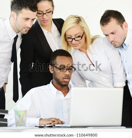 Business group colleagues discussing a project on laptop - stock photo