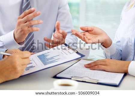 Business group discussing the present state of business affairs - stock photo