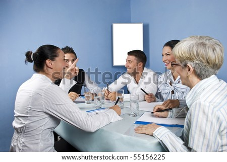 Business group having a meeting and they discuss and laughing together,blank chart for presentation in background - stock photo