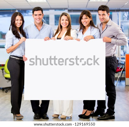 Business group holding a banner at the office - stock photo