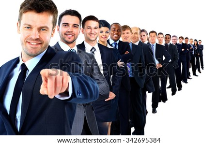 Business group in a row. leader pointing his finger at you - stock photo