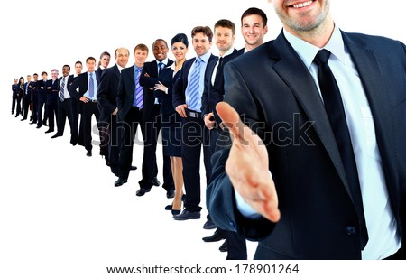 Business group in a row. leader with open hand and ready to shake your hand  - stock photo