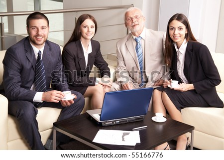Business group meeting portrait - four business people working together.
