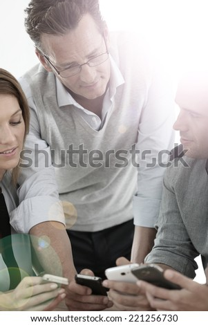 Business group meeting with smartphones - stock photo