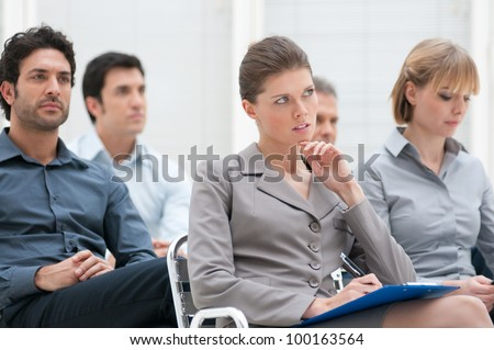 Business group of people attending an educational presentation - stock photo