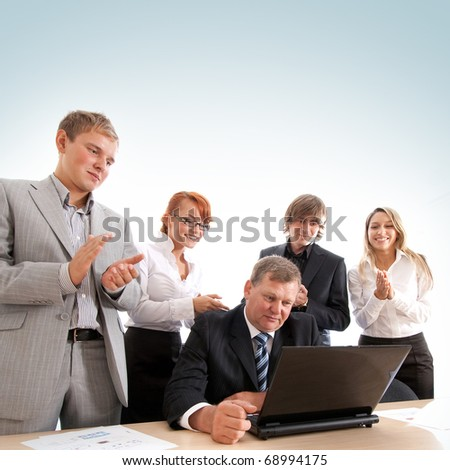 Business group of two young ladies, two young men and a mature boss at work isolated on white - stock photo
