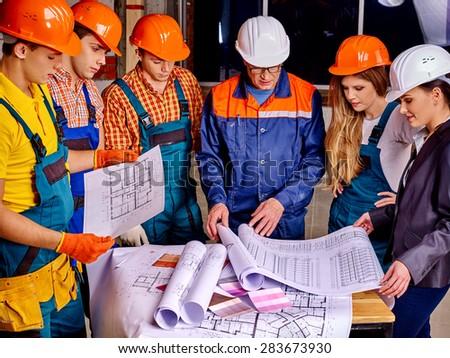 Business group people in builder helmet indoor. - stock photo