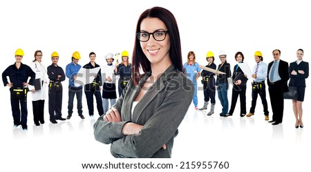 Business group with female leader in front - stock photo