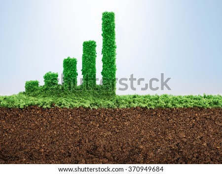 Business growth concept with grass growing in shape of graphic bar - stock photo