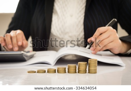 business growth concepts. close-up golden coins with business people working. - stock photo