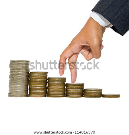 Business hand as finger stepping on heap of coins - stock photo