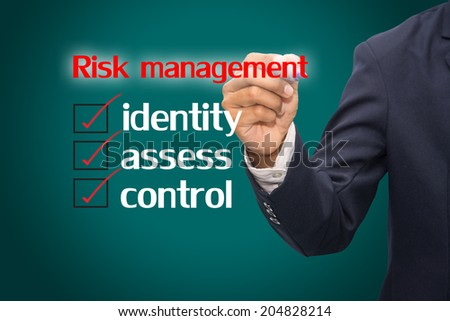 business hand checking the risk management