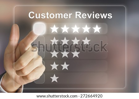 business hand clicking customer reviews on virtual screen interface - stock photo