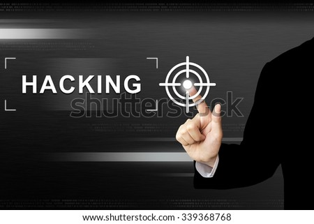 business hand clicking hacking button on a touch screen interface - stock photo