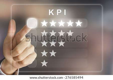 business hand clicking KPI or Key Performance Indicator on virtual screen interface - stock photo