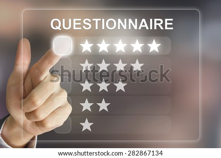 business hand clicking questionnaire on virtual screen interface - stock photo