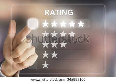 business hand clicking rating on virtual screen interface - stock photo