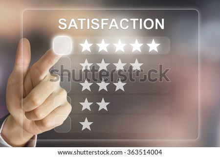 business hand clicking satisfaction on virtual screen interface - stock photo