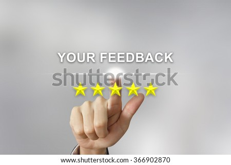 business hand clicking your feedback with five stars on screen - stock photo
