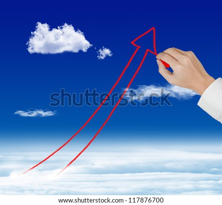 business hand drawing rising arrow graph over sky - stock photo