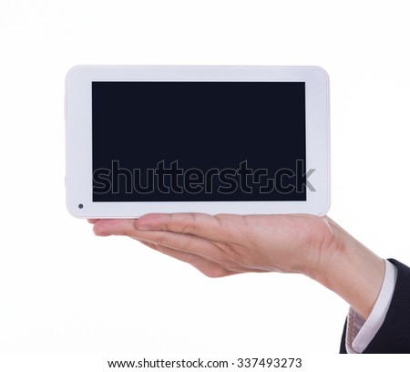 business hand holding a small tablet touch computer isolated on white background
