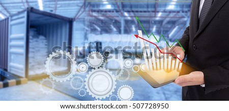 Business hand holding growth chart of transport business on tablet with supply chain management ,Logistic Import Export   background
