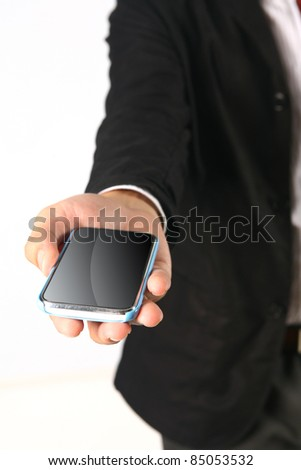 Business Hand holding smart phone on white - stock photo