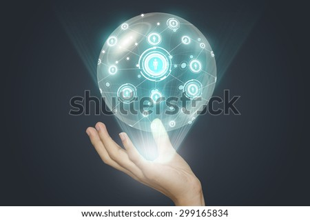 Business hand holding team. - stock photo