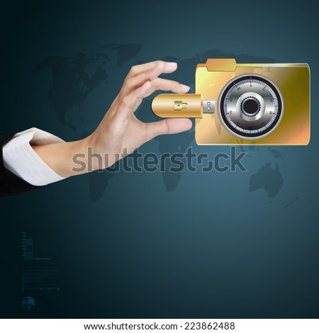 business hand holding USB stick with folder safe lock. - stock photo